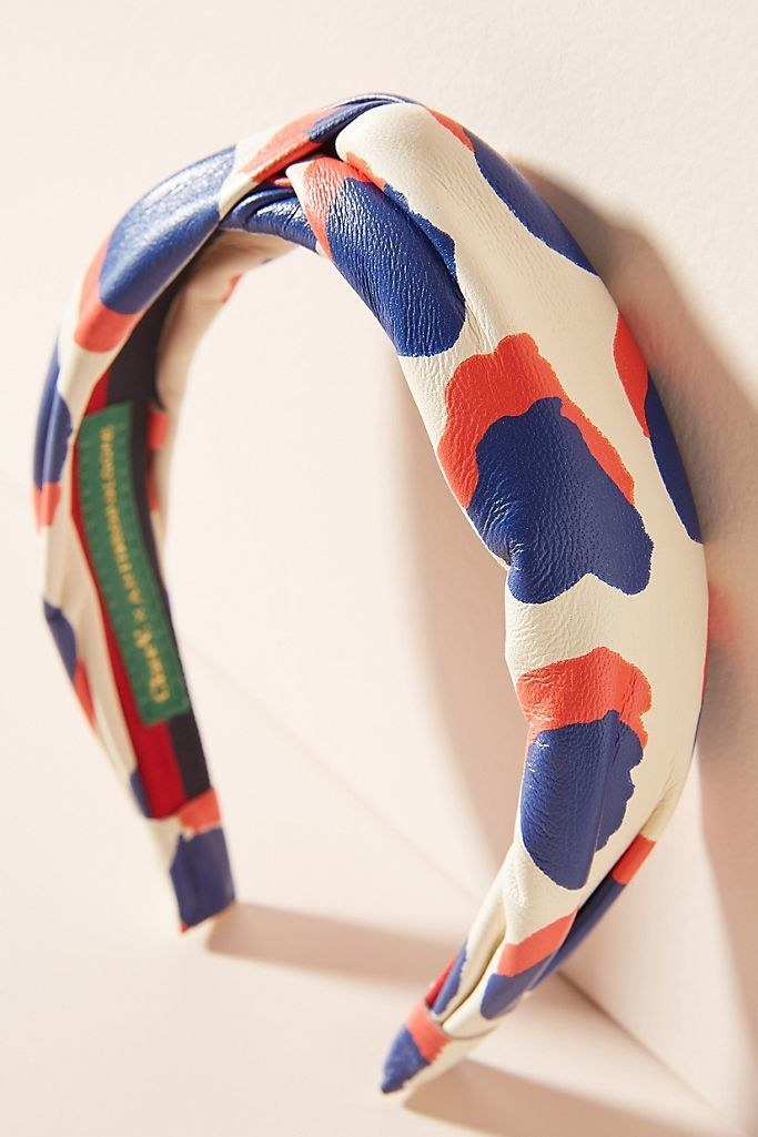 The Clare V. for Anthropologie Sabine Headband leaning on a wall.