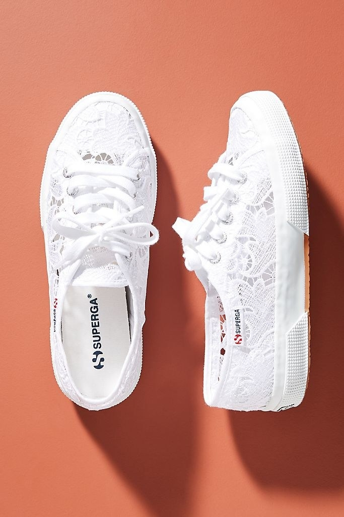 A photo of the low-top Superga lace sneakers in white.