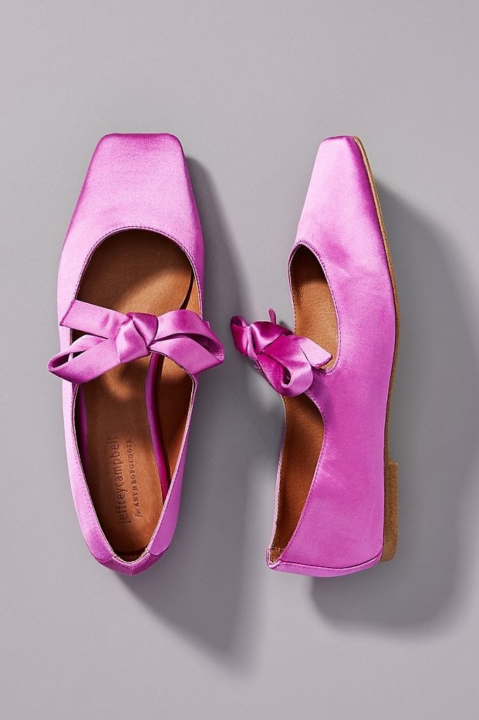 A pair of Jeffrey Campbell's Bow Square-Toed Flats in purple.