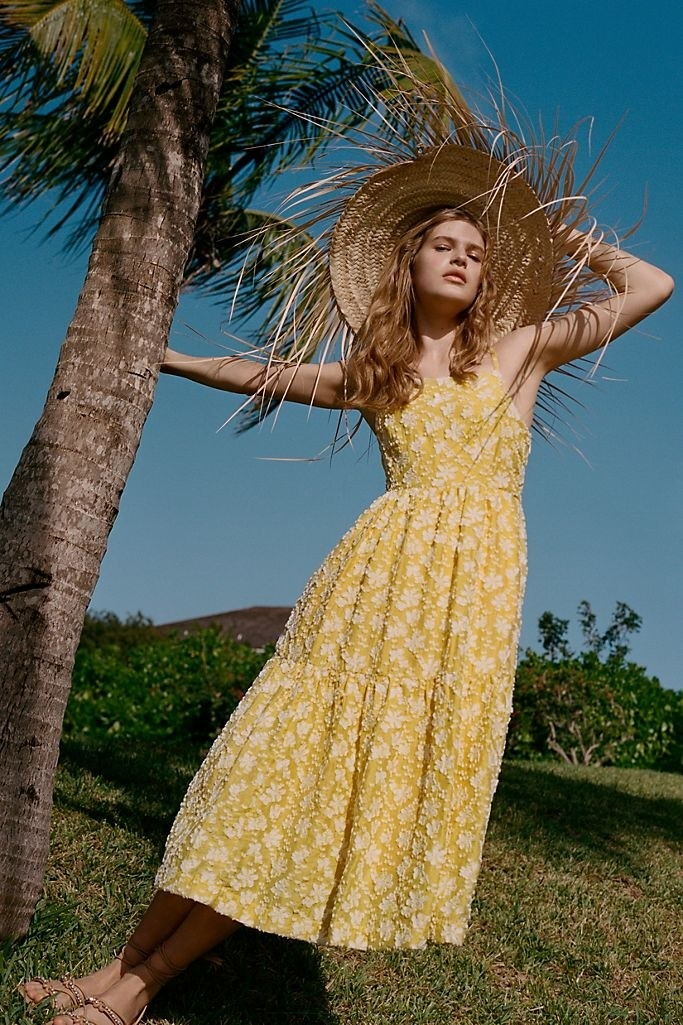 A model wearing the midi dress in yellow.