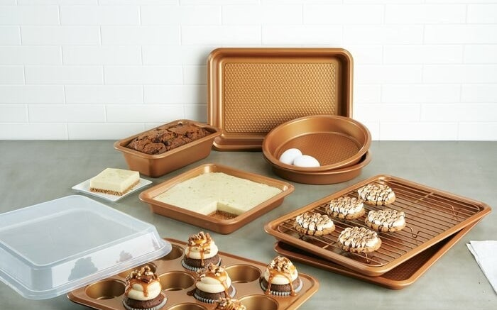A copper-colored bakeware set holding various baked treats
