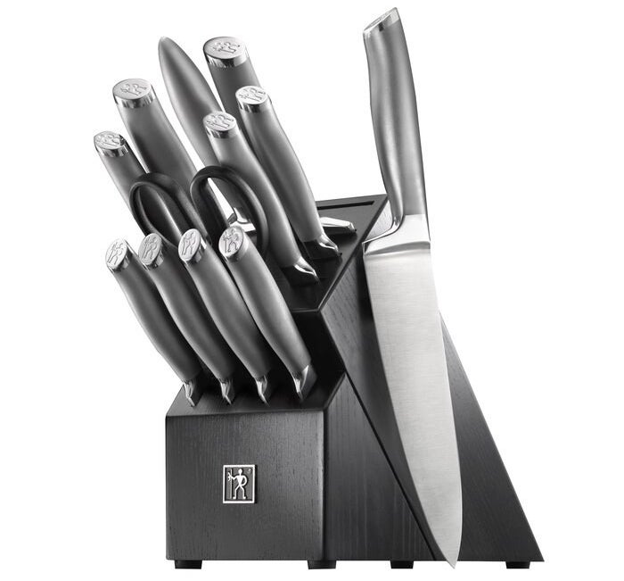 A black knife block with room for 11 knives and scissors