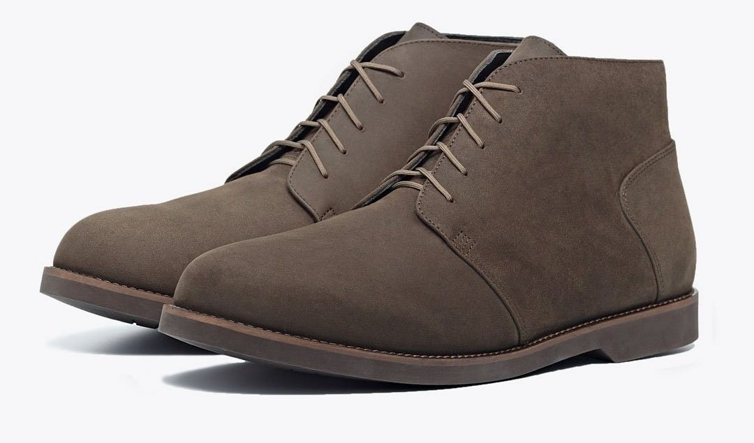 A dusty brown pair of Nisolo chukka boots