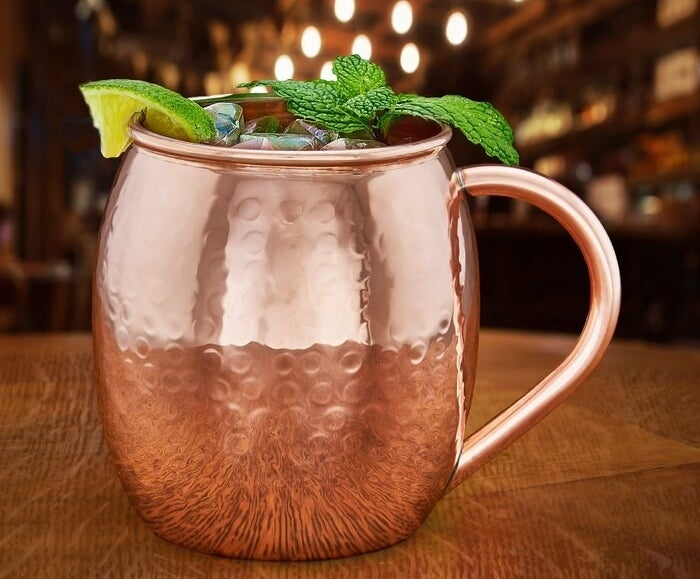 A Moscow Mule mug containing a cold, garnished drink