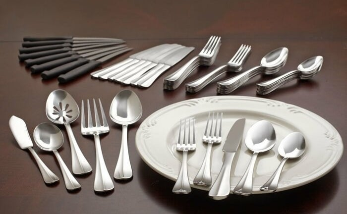A stainless steel flatware set organized by utensil