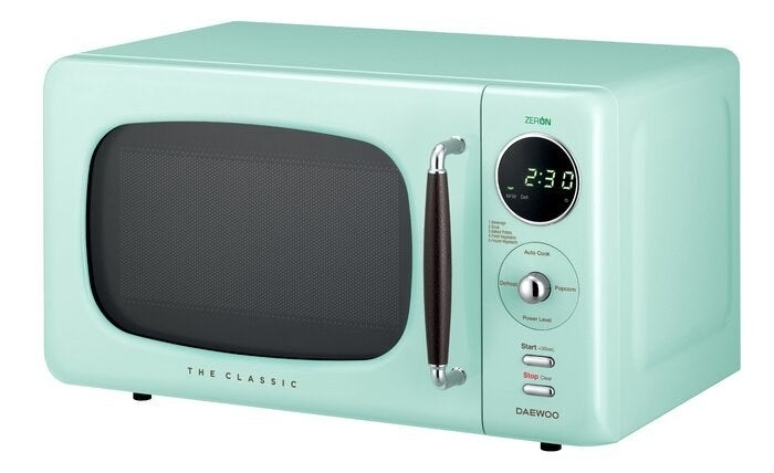 A teal microwave with rounded retro features