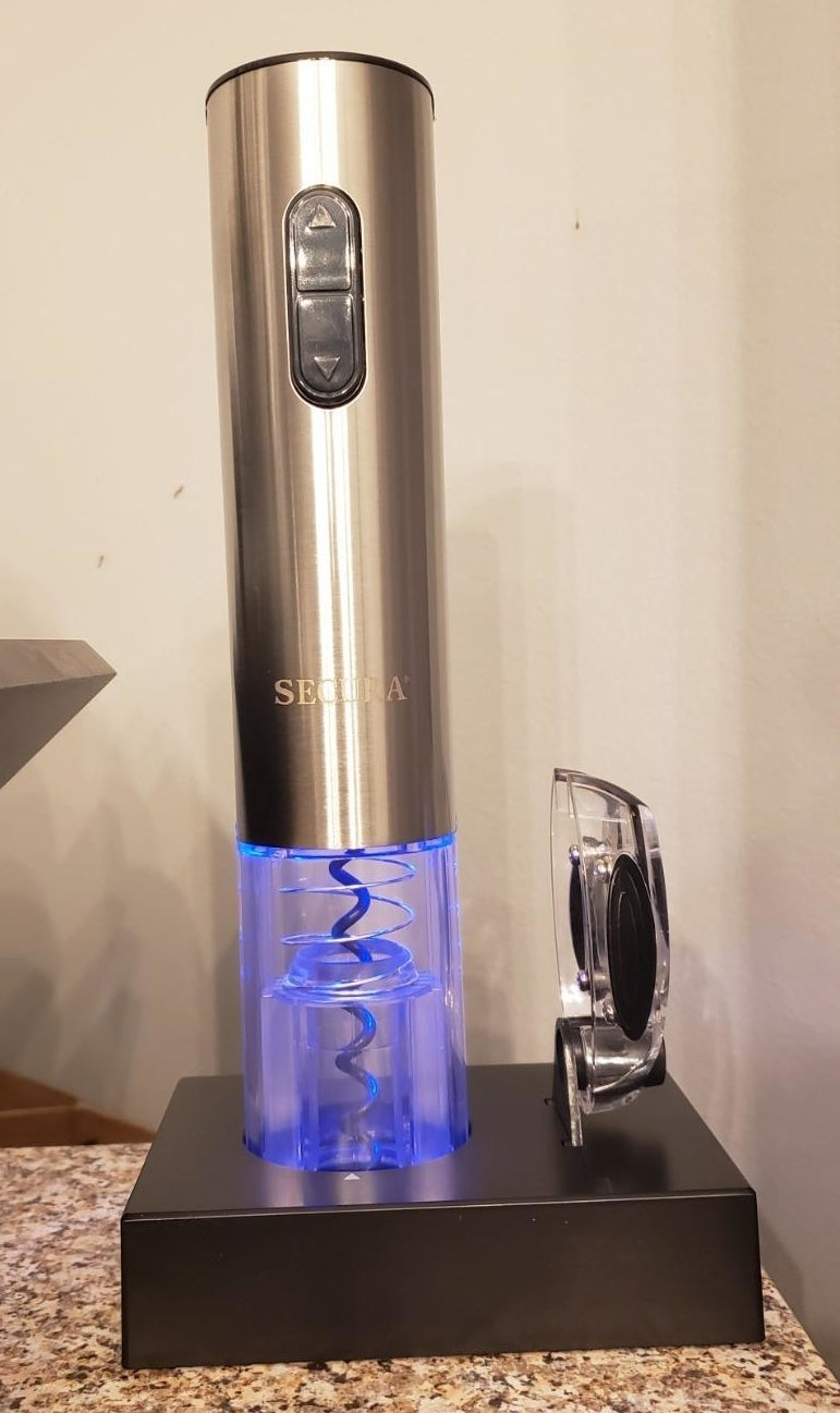 An electric wine opener the gives off a blue light
