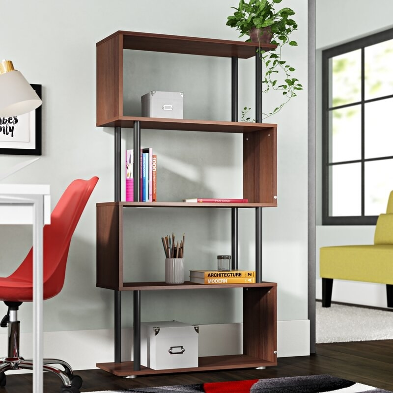 a dark wood and black bookcase with an s-like shape