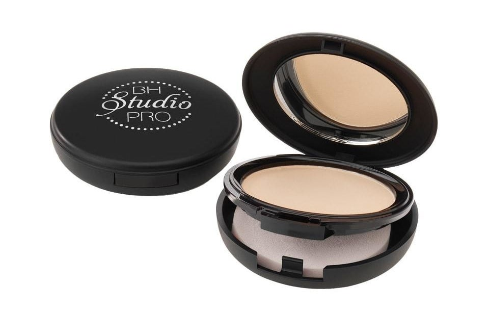 A mirrored powder compact with a compartment for a round makeup sponge