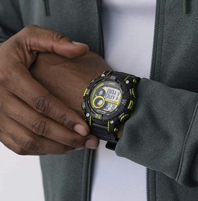 A model wears a yellow and black Armitron Sport Digital Chronograph Watch on their wrist