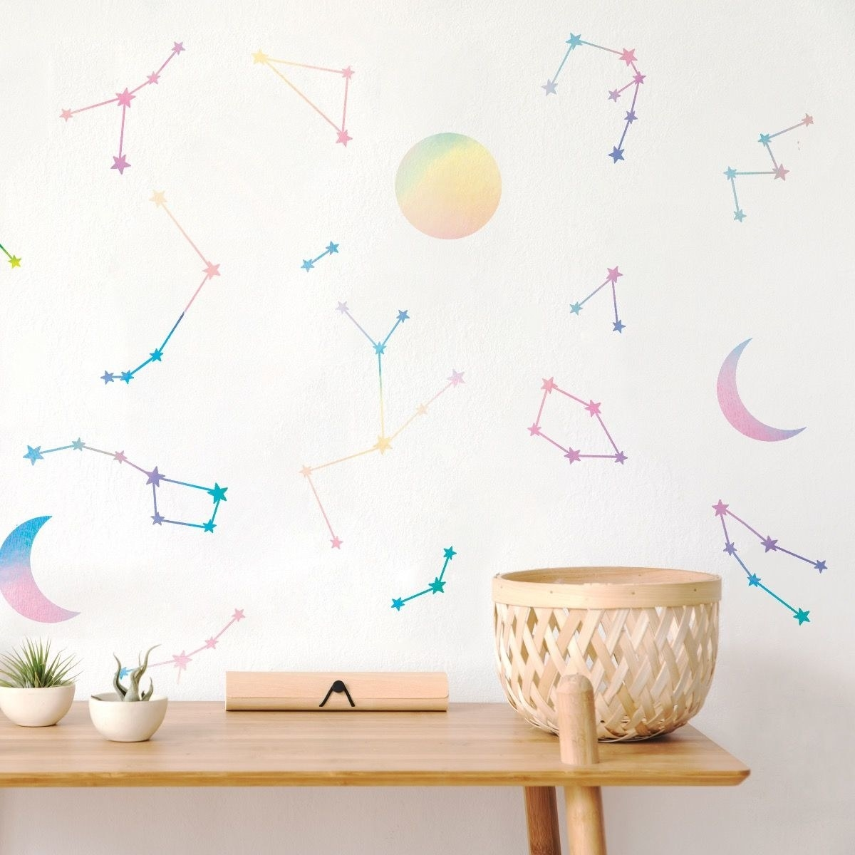A wall covered in rainbow constellations and moons