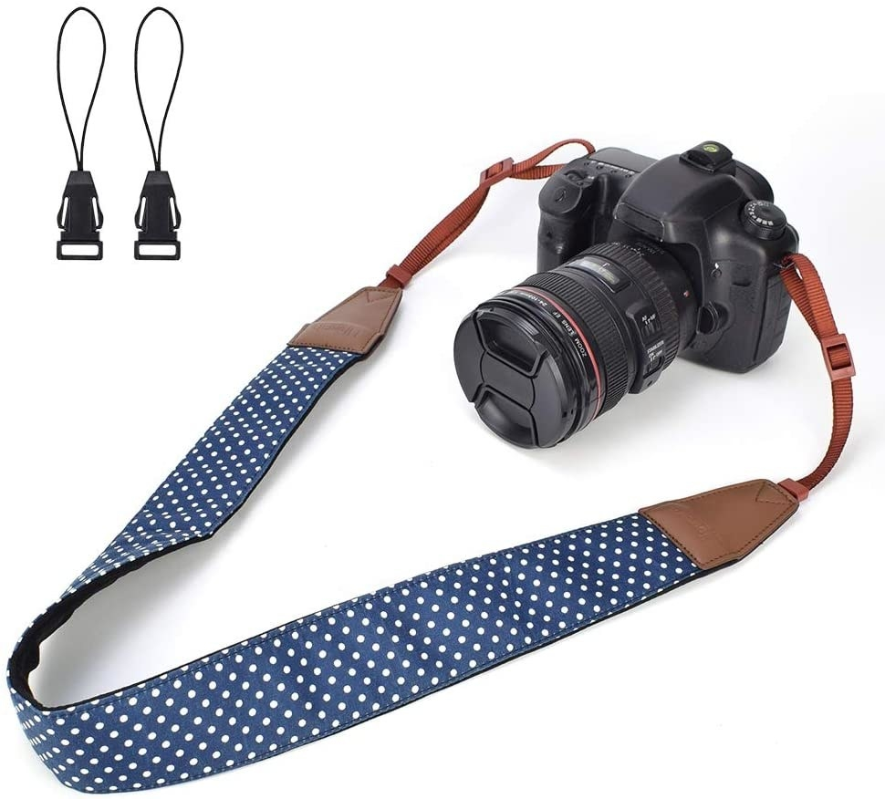 The polka dot strap attached to a medium-sized digital camera
