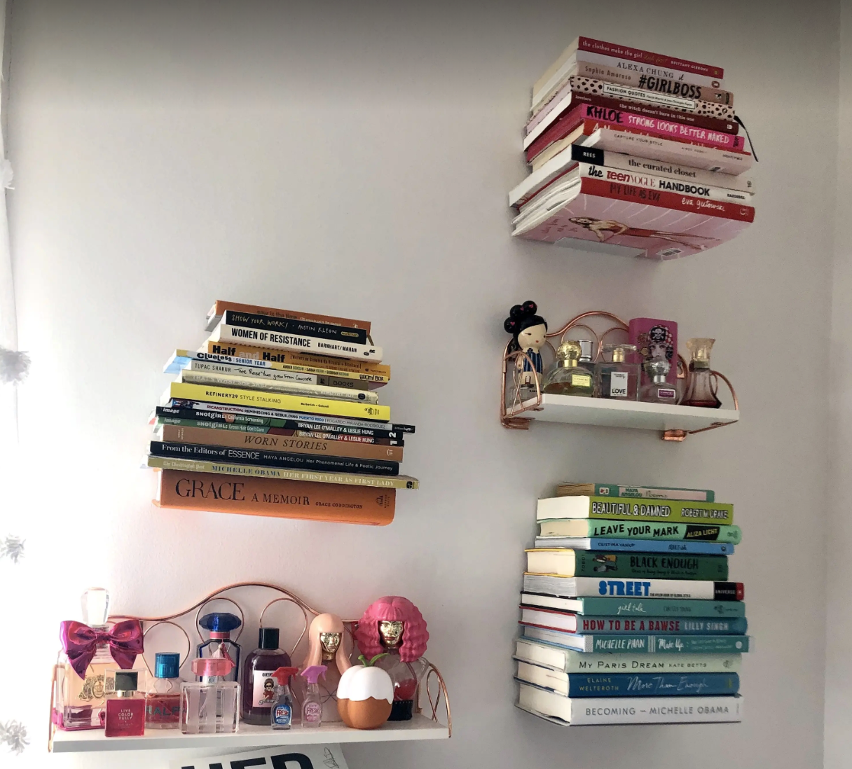 Several floating bookshelves on BuzzFeed editor Kayla Boyd's wall