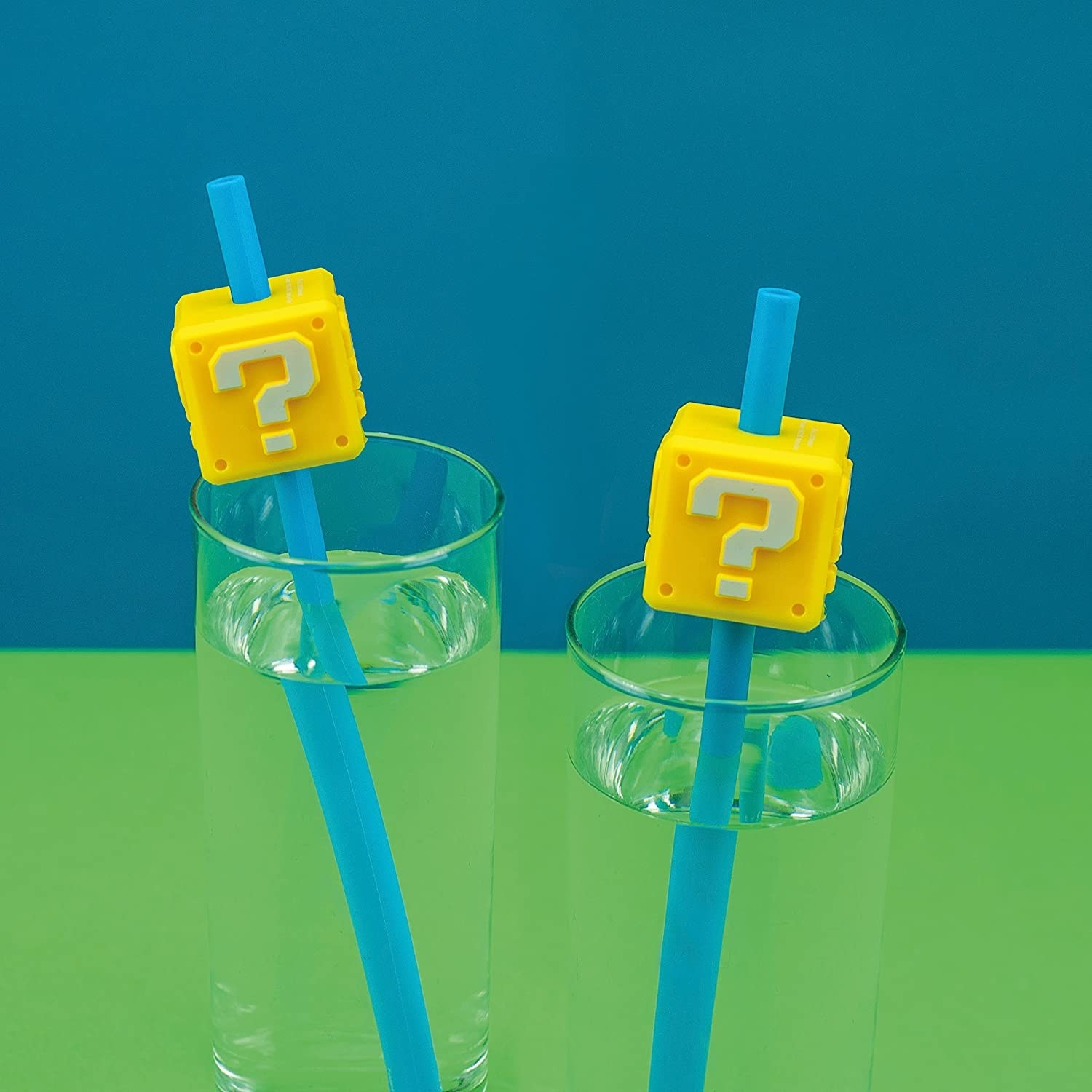 two blue straws with yellow question boxes