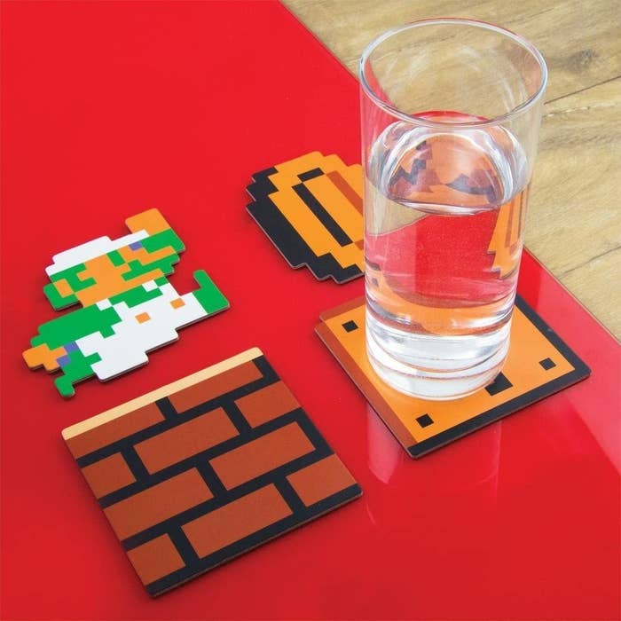 coasters shaped like mario, a coin, a brick box, and a question box