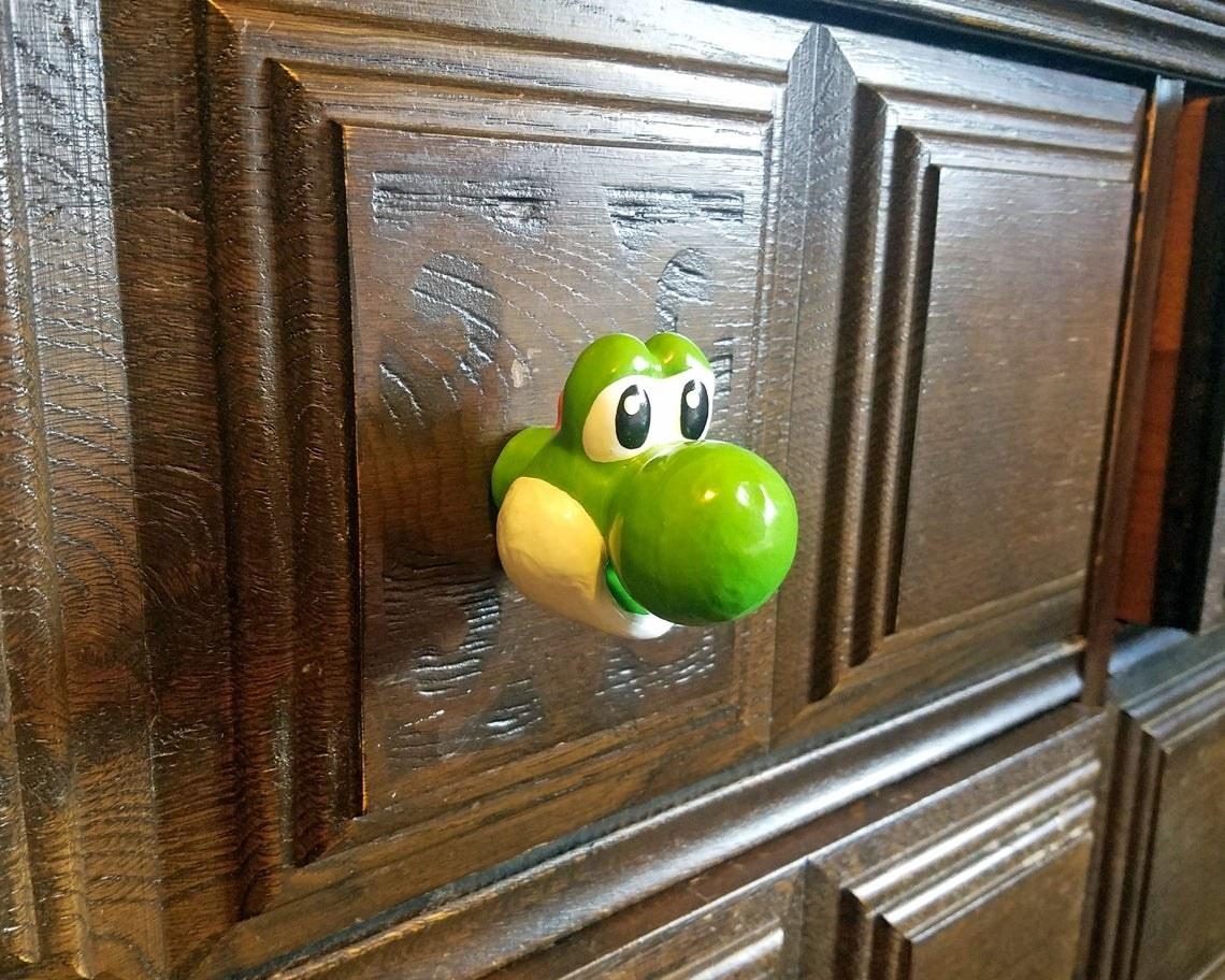 a green yoshi door knob