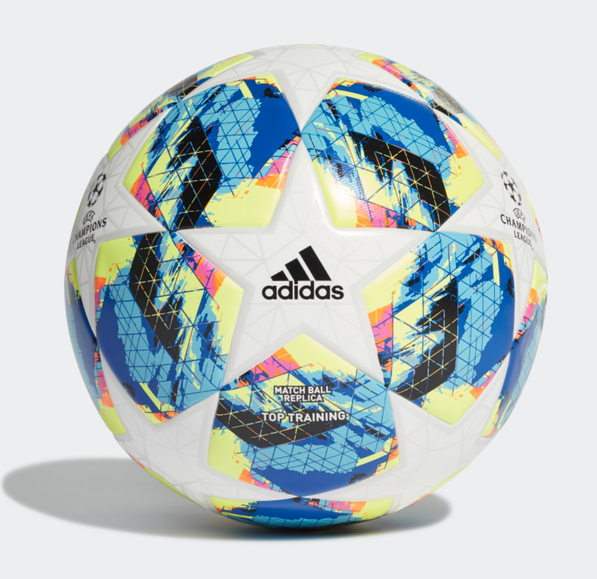 Adidas' Finale Top Training Ball covered in white stars, a colorful print, and an Adidas black logo
