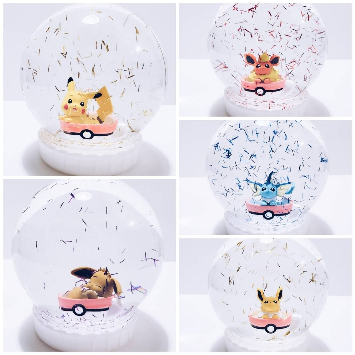 snow globes with confetti with eevee, pikachu, jolteon, vaporeon, or flareon inside