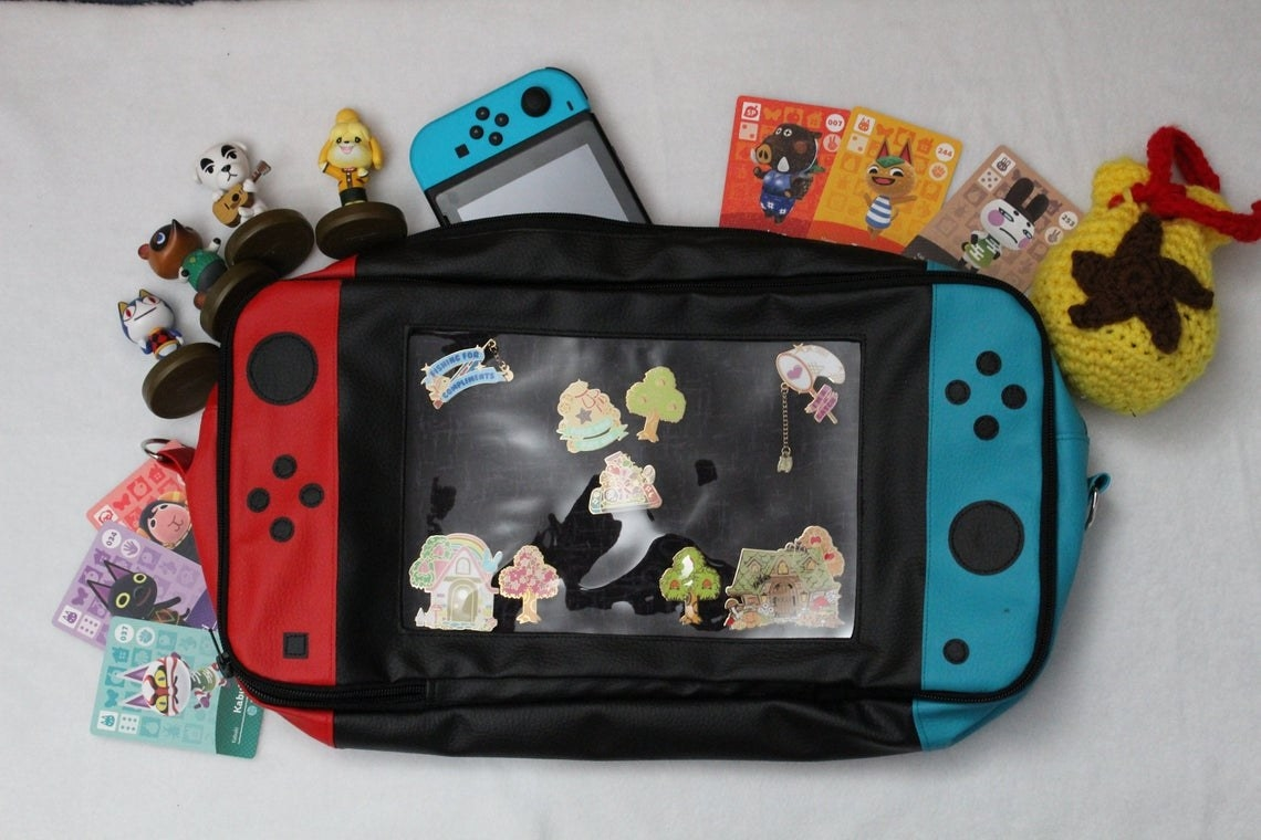 a switch ita bag with a clear window to show off the pin inside
