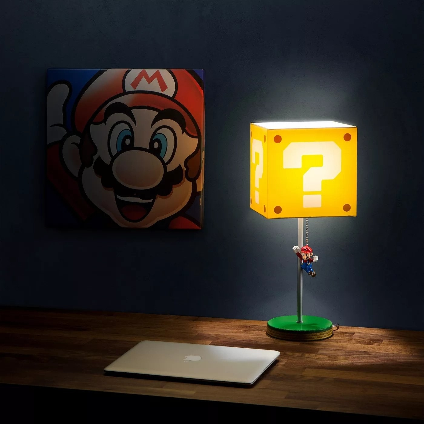 lamp with a yellow question box shade and a chain with a mario figure on the ned
