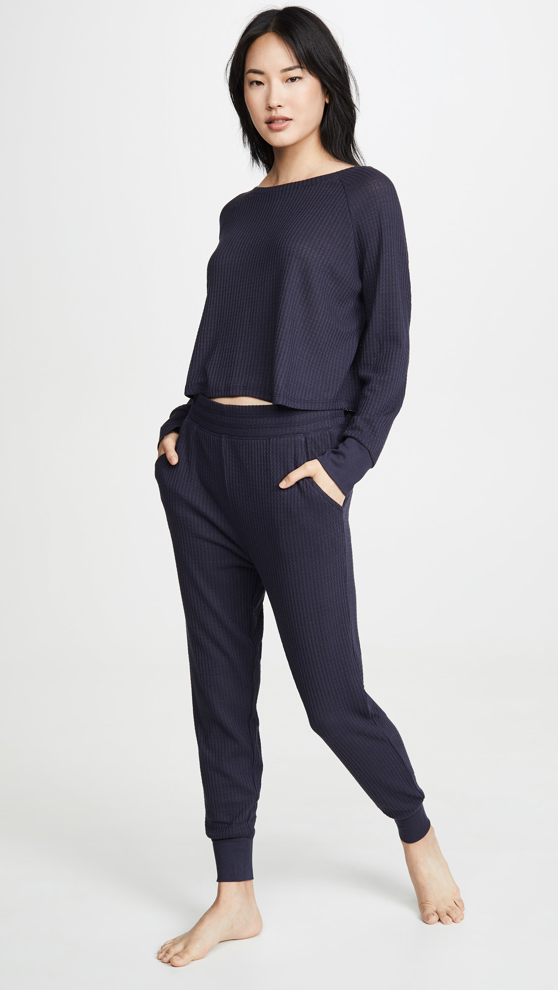 Model wearing the navy version of the pants with the matching longe-sleeve top