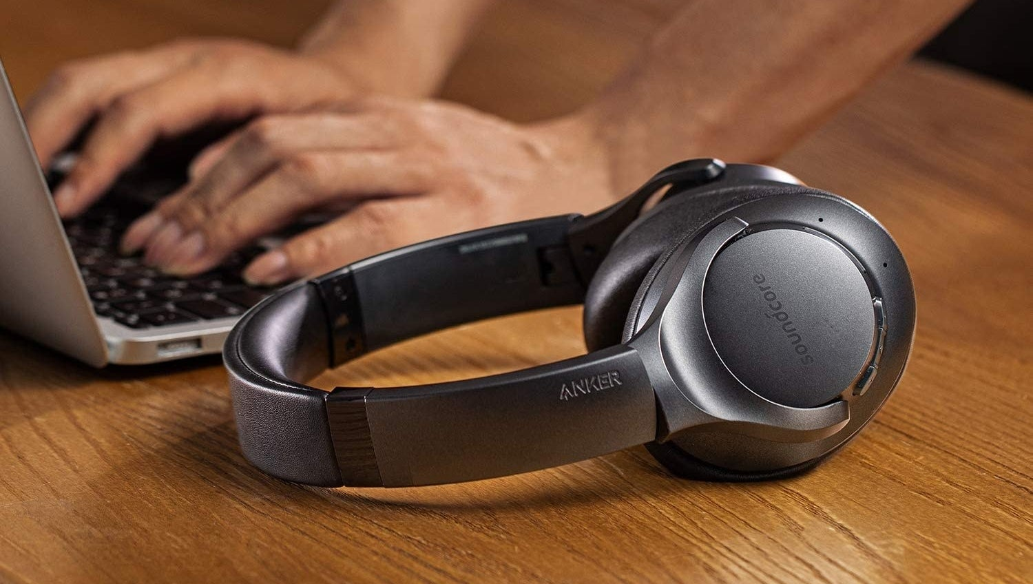 A set of Anker noise-canceling headphones set on a table