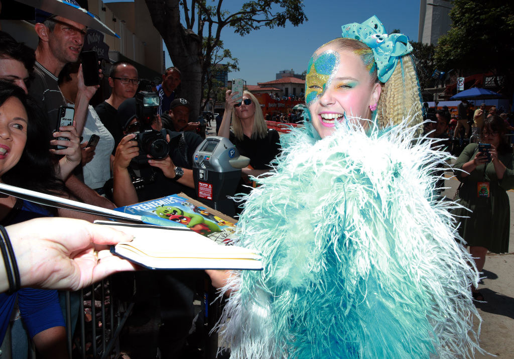 """JoJo signs autographs on the red carpet for """"Angry Birds 2""""."""