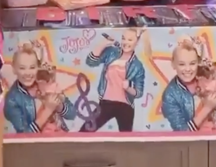 A banner splashed with pictures of JoJo helps to decorate the kitchen.