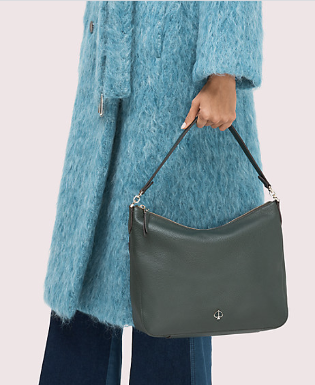 Model holding the slouchy-style shoulder bag in their hand