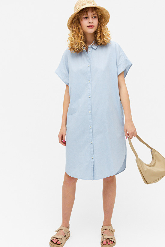Woman wearing blue shirt dress
