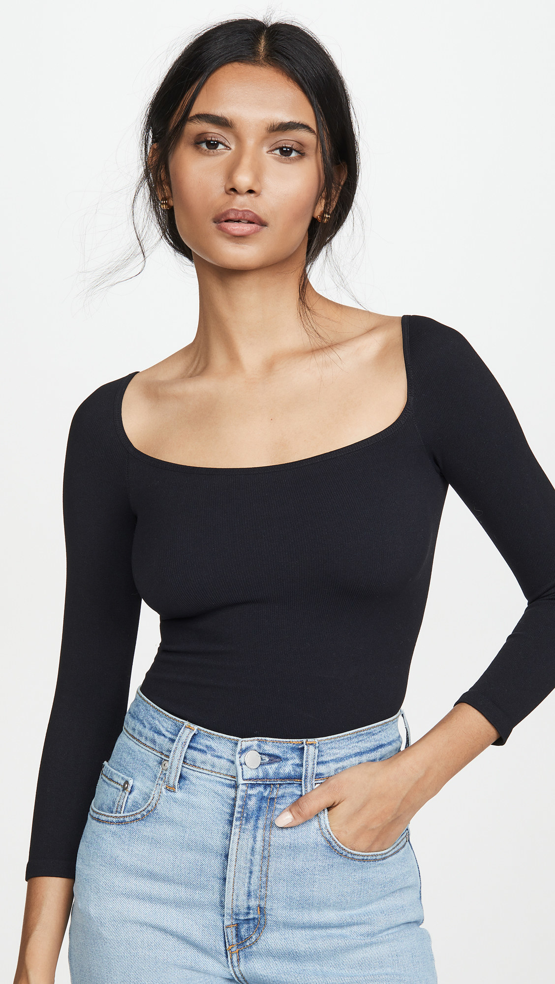 Model wearing top tucked into a pair of jeans
