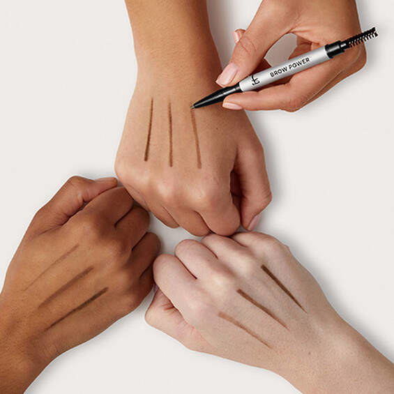 The eyebrow pencil swatched across hands with light, tan, and deep skin tones