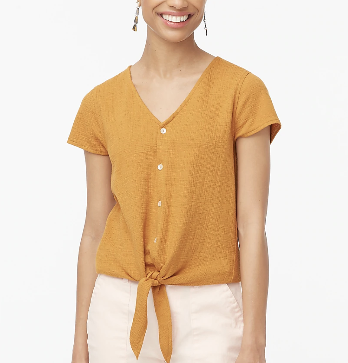 A model wears textured tie-front top in a burnished copper color