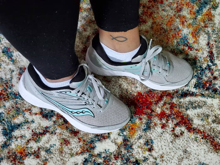 BuzzFeed Staff Taylor Steele wears the Saucony sneakers in gray