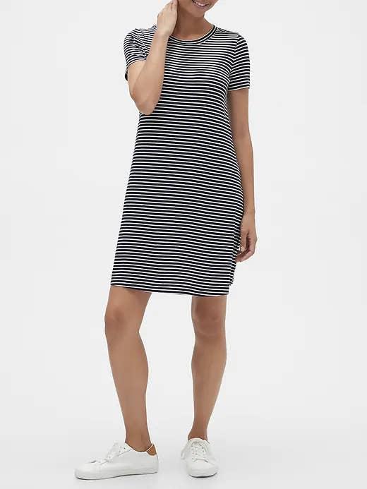 A woman wearing a midi length dress