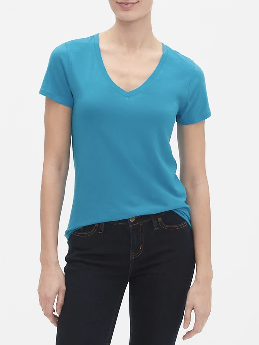 a woman wearing a blue v neck tee
