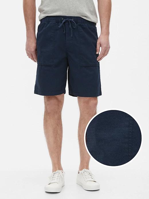 a man wearing lightweight blue shorts