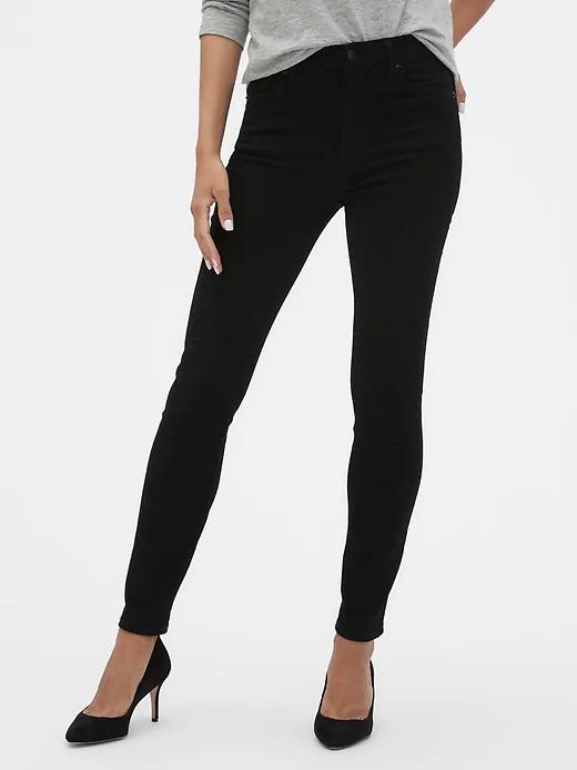 a woman wearing black skinny jeans