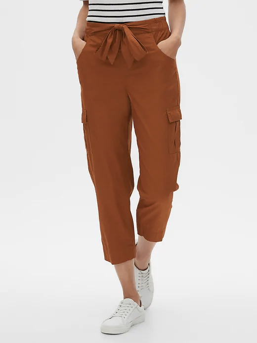 a woman wearing burnt orange pants with large side pockets