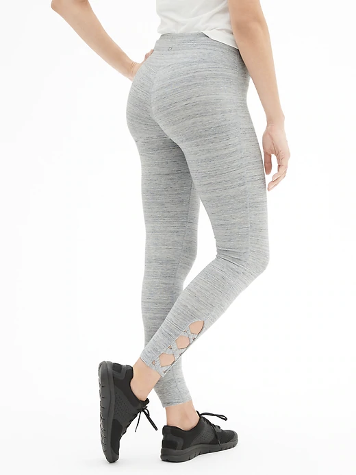 a woman wearing grey leggings