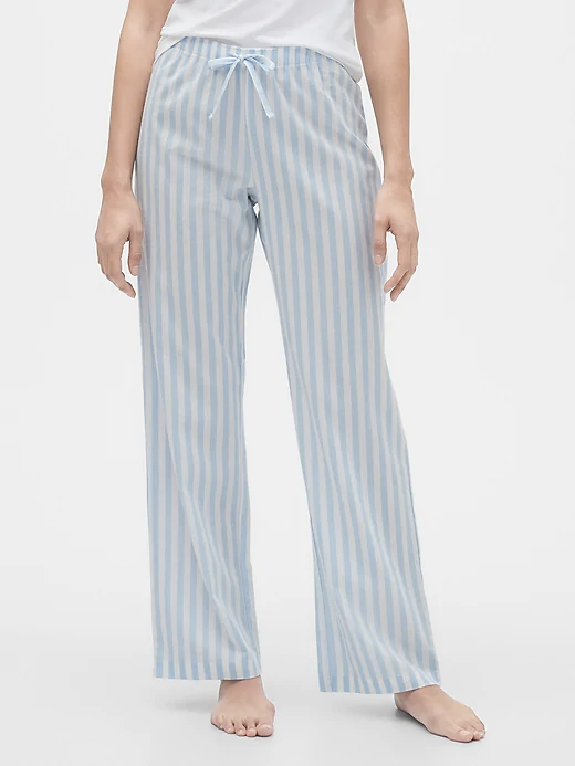 a woman wearing blue striped pajamas
