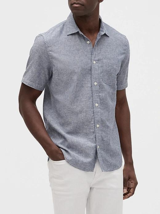 a man wearing a grey linen short sleeve shirt