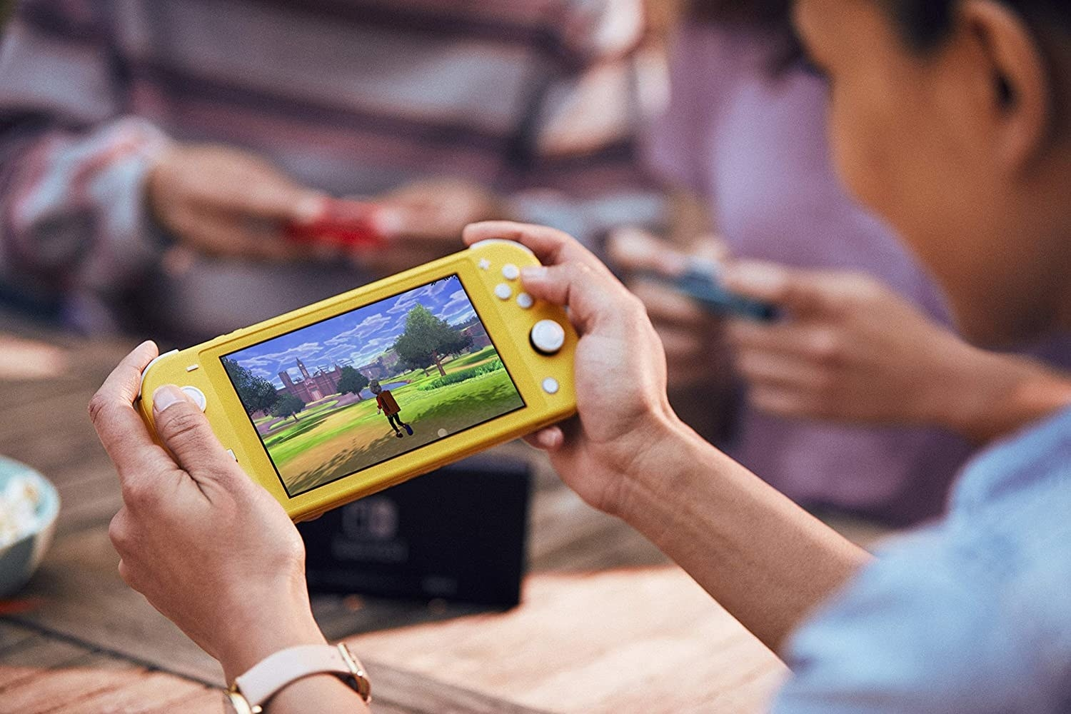 Man holding yellow Nintendo Switch Lite