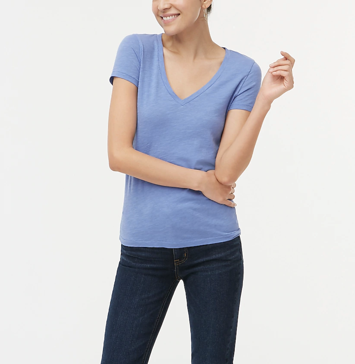 A model wears a periwinkle V-neck cotton tee with jeans