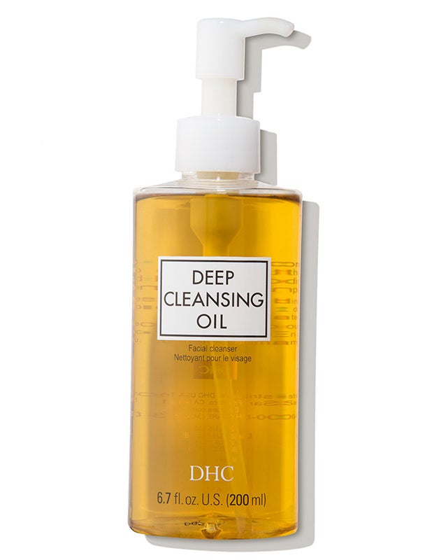 A bottle of the DHC Deep Cleansing Oil featuring a pump nozzle