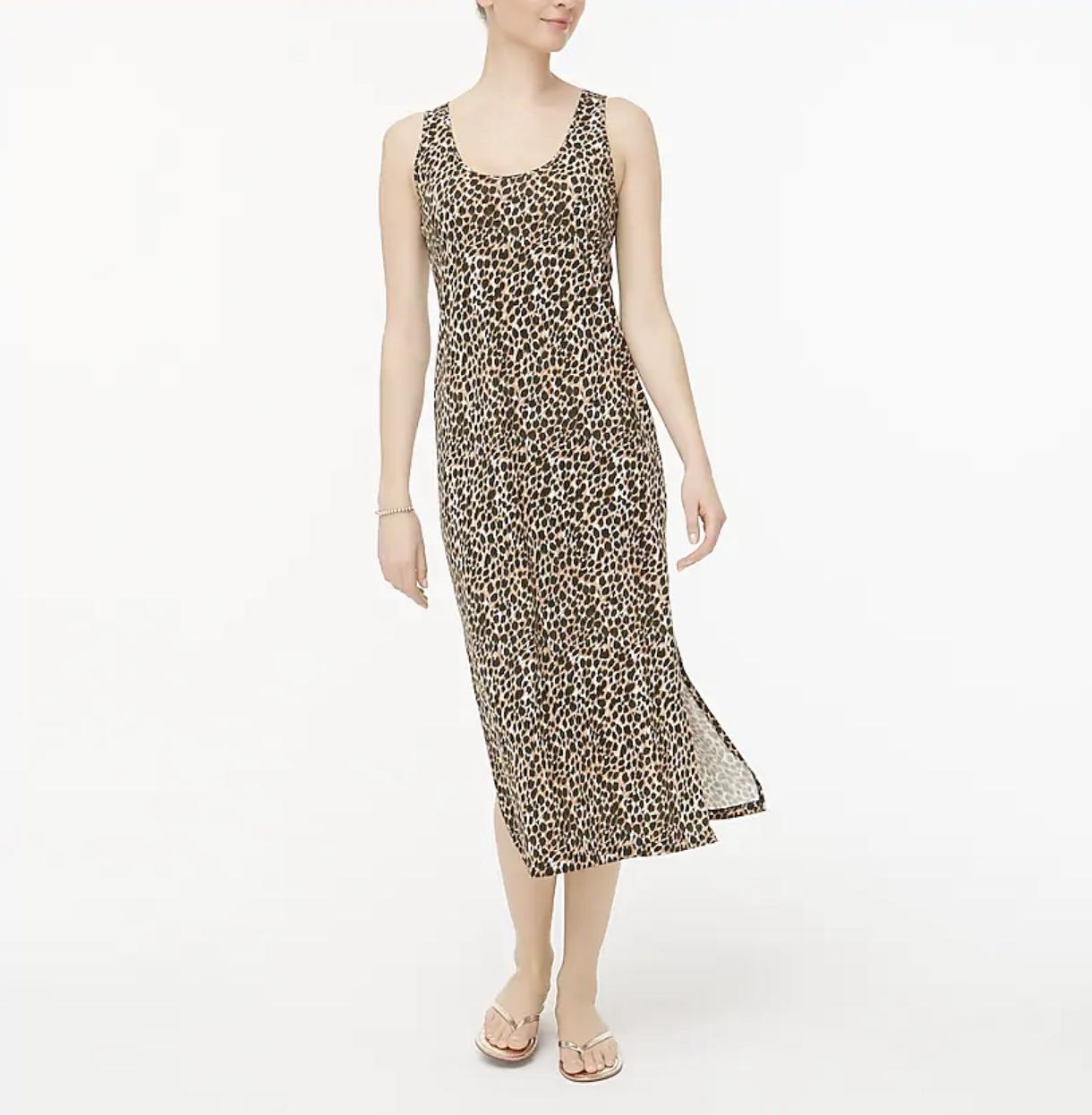 A model wears a leopard-print sleeveless knit midi dress