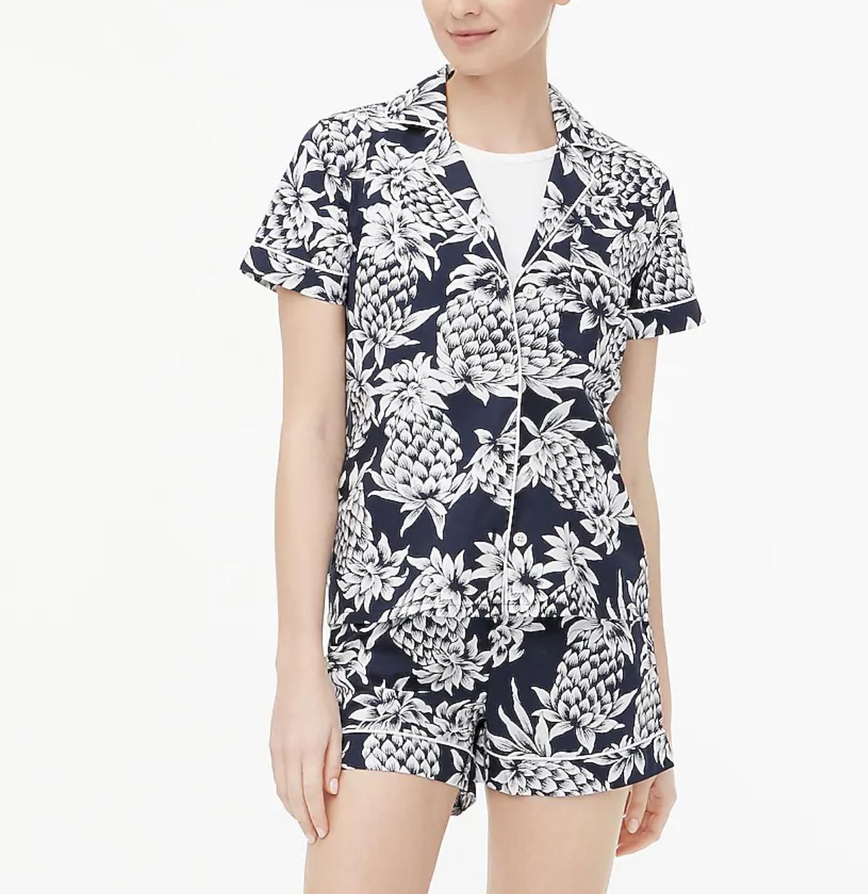 A model wears short-sleeve pajama set in a pineapple print