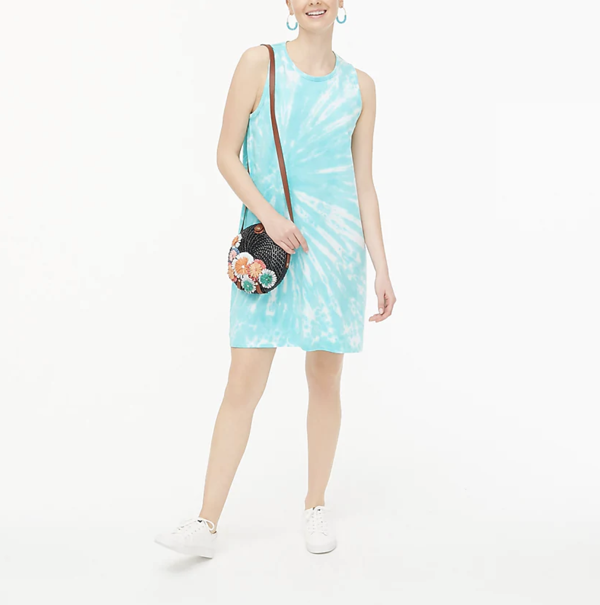 A model wears the blue tie-dyed cotton dress