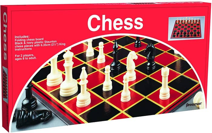 A box of basic chess set with a black and red board and white and black pieces