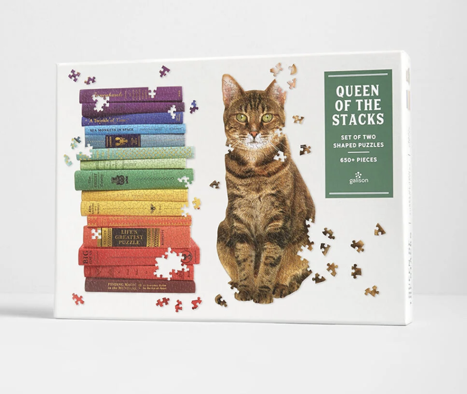 A puzzle box showing two puzzles, one that's a stack of books and the other a cat sitting down